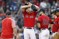 Boston Red Sox pitching coach Dana LeVangie, left, comes to the mound to talk with Chris Sale, center, during the first inning of a baseball game against the Toronto Blue Jays in Boston, Friday, June 21, 2019. (AP Photo/Michael Dwyer)