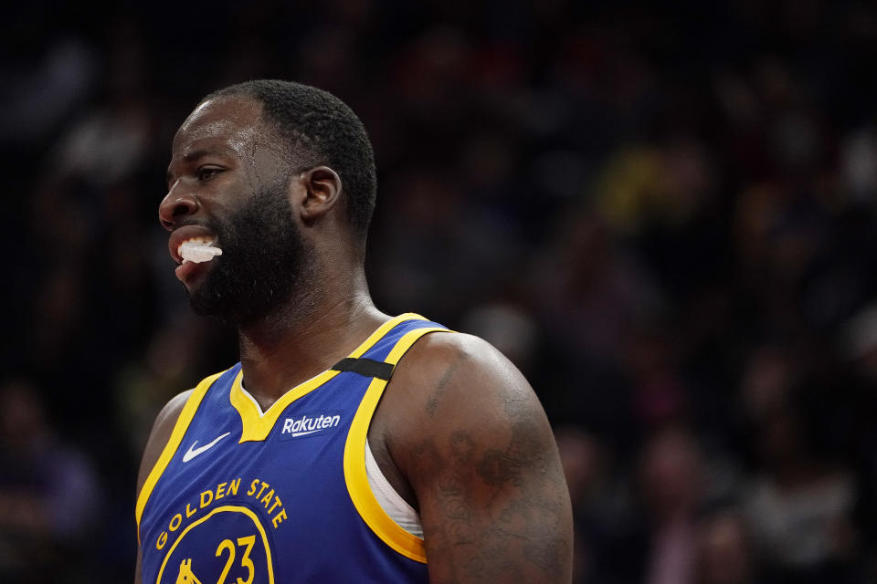 Draymond Green #23 of the Golden State Warriors looks on against the Washington Wizards in the second half at Capital One Arena.