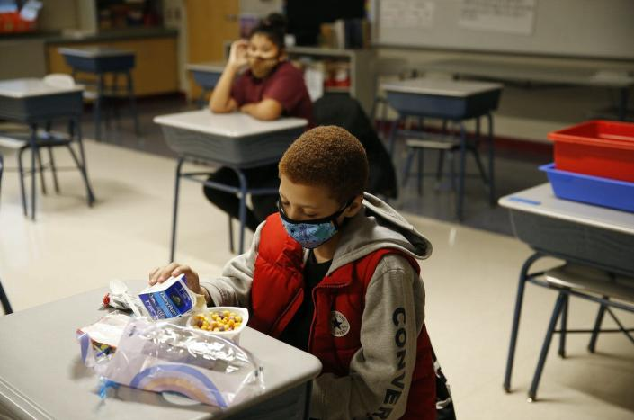 "<span class=""caption"">Chronic absenteeism rates fell 8 percentage points among schools in Nevada and Colorado that adopted the 'Breakfast after the Bell' program. </span> <span class=""attribution""><a class=""link rapid-noclick-resp"" href=""https://www.gettyimages.com/detail/news-photo/fourth-grader-eats-breakfast-before-the-start-of-the-day-at-news-photo/1229943333?adppopup=true"" rel=""nofollow noopener"" target=""_blank"" data-ylk=""slk:Jessica Rinaldi/The Boston Globe via Getty Images"">Jessica Rinaldi/The Boston Globe via Getty Images</a></span>"