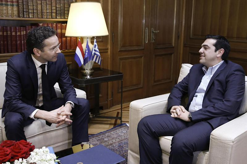 Eurogroup chairman Jeroen Dijsselbloem (L) speaks with Greece's new Prime Minister Alexis Tsipras during their meeting in Athens on January 30, 2015 (AFP Photo/Petros Giannakouris)