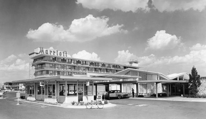 This undated photo provided by Marriott International, Inc. shows the Twin Bridges Marriott, in Arlington, Va. In 1957, John Willard Marriott and Alice Sheets Marriott opened their first hotel _ the Twin Bridges Motor Hotel in Arlington, Va. But it was their son Bill who transformed the company into a global hotel giant. Today there are 3,718 Marriott hotels in 73 countries. The company's other businesses have been sold.. (AP Photo/Marriott International, Inc.)