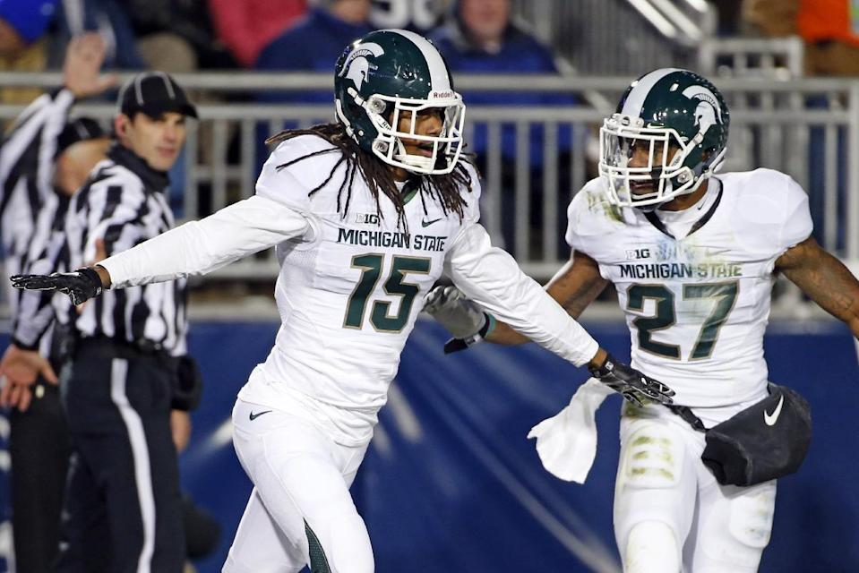 Michigan State cornerback Trae Waynes (15) celebrates with Kurtis Drummond (27) after intercepting a pass in the end zone for a touchback during the second half of an NCAA college football game in State College, Pa., Saturday, Nov. 29, 2014. (AP Photo/Gene J. Puskar)