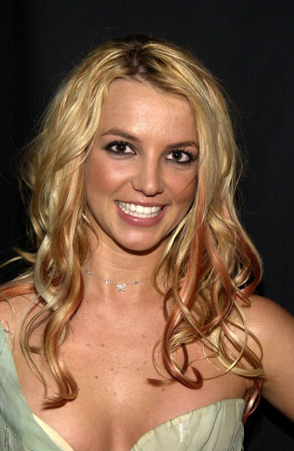<p>Britney was an early adopter of the red lowlight trend. She even mixed in purple-red pieces at the American Music Awards. </p>