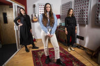 """Members of the folk group The Staves, sisters, from left, Jessica, Camilla and Emily Staveley-Taylor pose in a north London recording studio to promote their album """"Good Woman"""", on Monday, Feb. 15, 2021. (Photo by Joel C Ryan/Invision/AP)"""