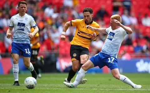 Robbie Willmott of Newport County shoots during the Sky Bet League Two play-off final - Credit: Getty Images