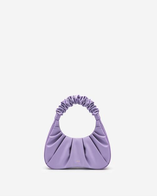 """Give your handbag collection a summer upgrade with this under-$60 mini bag. <br> <br> <strong>JW PEI</strong> Gabbi Bag - Purple, $, available at <a href=""""https://go.skimresources.com/?id=30283X879131&url=https%3A%2F%2Fwww.jwpei.com%2Fcollections%2Fshop-all%2Fproducts%2Fgabbi-bag-purple"""" rel=""""nofollow noopener"""" target=""""_blank"""" data-ylk=""""slk:JW PEI"""" class=""""link rapid-noclick-resp"""">JW PEI</a>"""