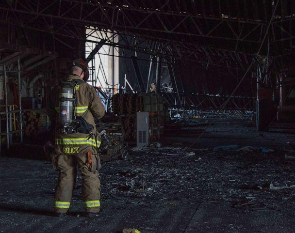 PHOTO: Federal firefighters assess damage in the hangar bay aboard the amphibious assault ship USS Bonhomme Richard (LHD 6), July 15, 2020. (Mc2 Natalie M. Byers/U.S. Navy)