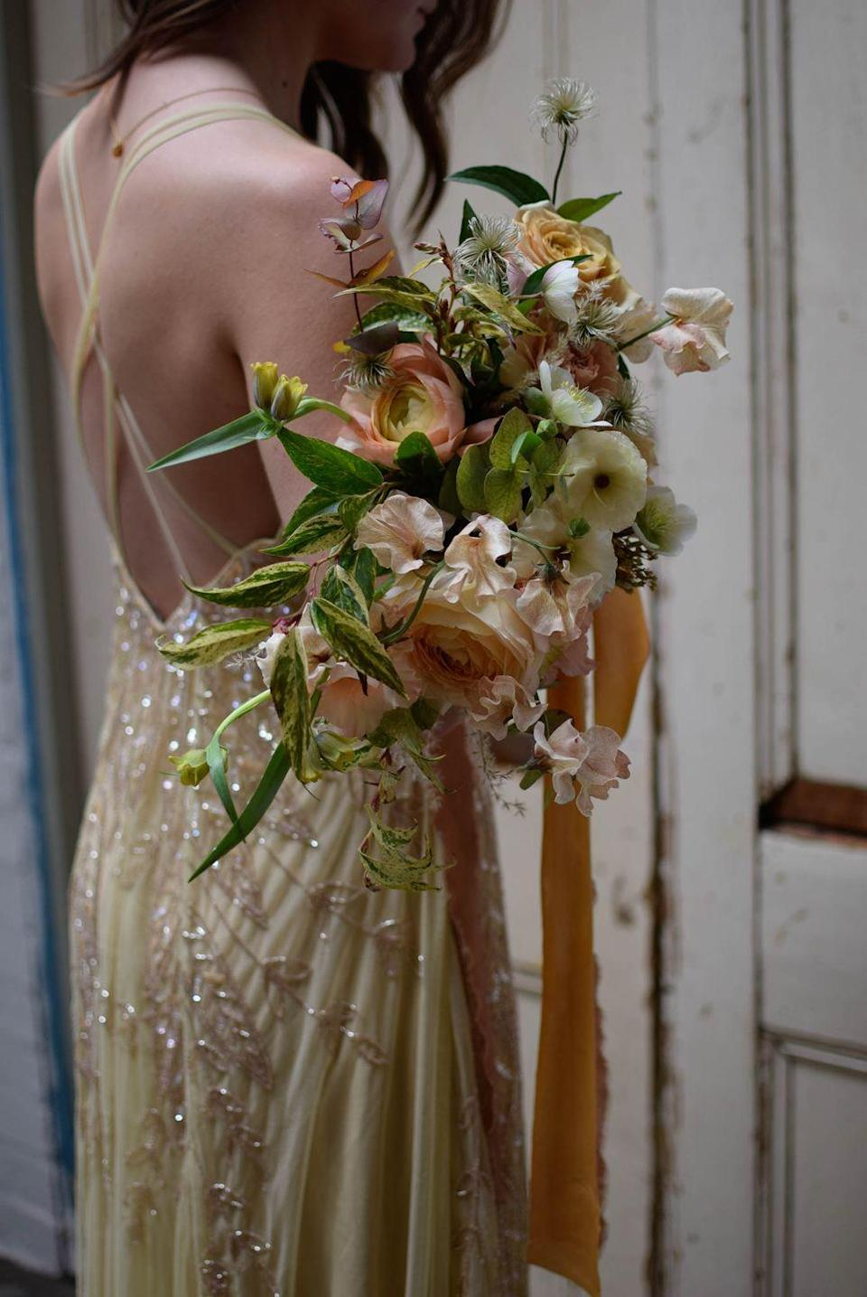 """<p>Floral delivery service Petalon keep things simple when it comes to wedding flowers, offering just two different types of service. </p><p>The first is a wedding package including beautiful bouquets, buttonholes and table flowers which a bride or groom selects from a menu, choosing from one of four colour palettes. The second is a bespoke design, whether it be for flower arches, flower clouds or installations, which includes a one-to-one chat with its experts.</p><p>Oh, and did we mention its flowers deliveries are done by bicycle seven days a week, with flowers wrapped in hessian with a small water supply.</p><p>Click <a href=""""http://www.petalon.co.uk"""" rel=""""nofollow noopener"""" target=""""_blank"""" data-ylk=""""slk:here"""" class=""""link rapid-noclick-resp"""">here</a> to find out more.</p>"""