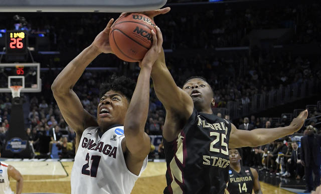 Florida State forward Mfiondu Kabengele (25) defends on a shot by Gonzaga forward Rui Hachimura (21) during the second half of an NCAA men's college basketball tournament regional semifinal Thursday, March 22, 2018, in Los Angeles. (AP Photo/Jae Hong)