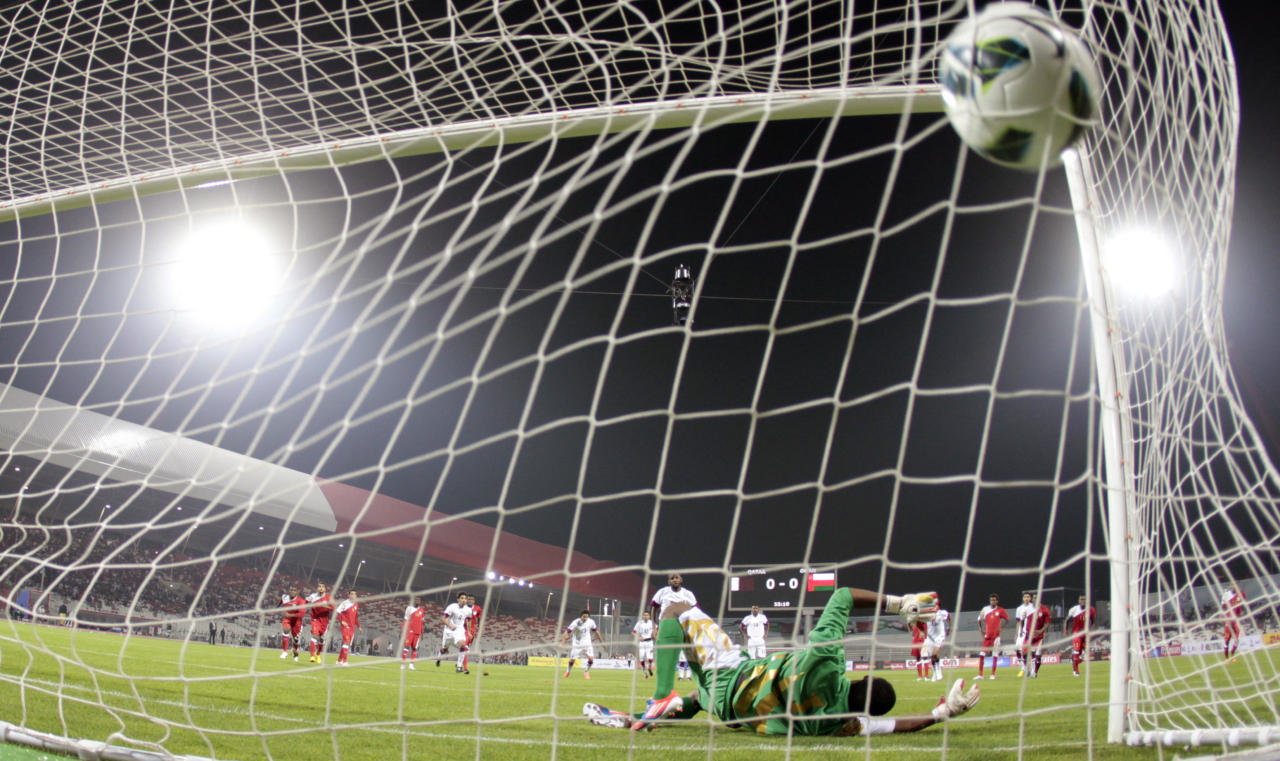 Qatar's Khalifan Ibrahim scores the first goal in a penalty kick against Oman during the Gulf Cup Tournament soccer match at Isa Sports City in Isa Town January 8, 2013. REUTERS/Fadi Al-Assaad (BAHRAIN - Tags: SPORT SOCCER)