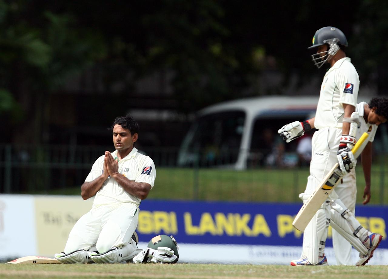 COLOMBO, SRI LANKA - JUNE 30:  Mohammad Hafeez (L) of Pakistan prays as he celebrates after scoring his first century against Sri Lanka as Azhar Ali walks during day one of the second test between Sri Lanka and Pakistan at Sinhalese Sports Club on June 30, 2012 in Colombo, Sri Lanka.  (Photo by Buddhika Weerasinghe/Getty Images)