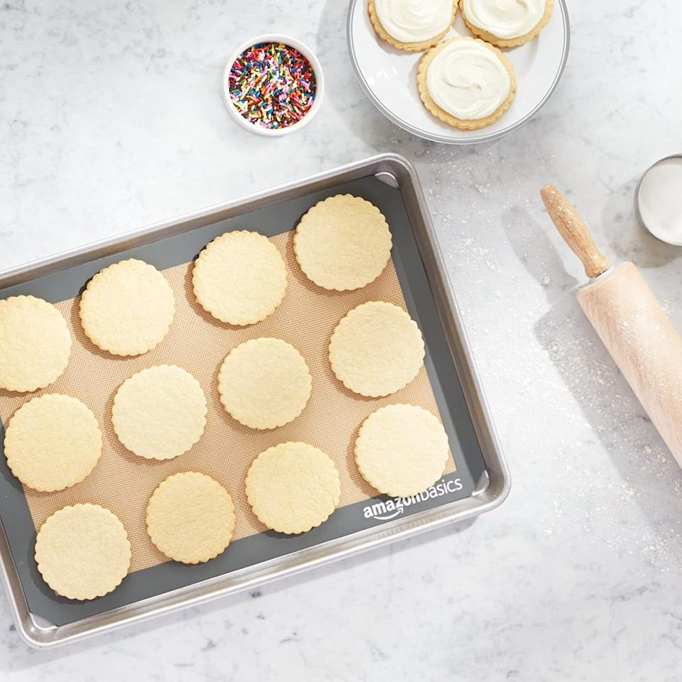 """Add this to your sheet pan, and you'll be able to roast big batches of veggies with all your favorite sauces and seasonings without worrying about your pans (or wasting parchment paper).<br /><br /><strong>Promising review</strong>: """"I like to do what I can to reduce my carbon footprint but I don't want to make my life unnecessarily difficult or ineffective. These mats allow me to eliminate the use of foil or parchment paper on my baking sheets, thereby saving money and being that much less potential product in the landfill.<strong>So far I have baked breadsticks and roasted vegetables on them, and they work like a charm. The heat distribution is great and they're nonstick without using spray or oil.</strong>If I had a complaint, it would be that they're a little hard to clean by hand due to how bendy and flexible they are and the fact that oil and grease seem to want to stick to it like a magnet. It isn't a big deal, though, and I'll be buying more of these."""" —<a href=""""https://www.amazon.com/gp/customer-reviews/R1V4ZVBZMQGI7C?ie=UTF8&ASIN=B0725GYNG6&linkCode=ll2&tag=huffpost-bfsyndication-20&linkId=27606e15facf3b6c2ba20a72717fd6d5&language=en_US&ref_=as_li_ss_tl"""" target=""""_blank"""" rel=""""noopener noreferrer"""">Michelle Daniels</a><br /><br /><strong>Get a set of two from Amazon for<a href=""""https://www.amazon.com/AmazonBasics-Silicone-Baking-Mat-Sheet/dp/B0725GYNG6?&linkCode=ll1&tag=huffpost-bfsyndication-20&linkId=82b7de368372a1d8737ebe8687328a15&language=en_US&ref_=as_li_ss_tl"""" target=""""_blank"""" rel=""""noopener noreferrer"""">$15.29</a>.</strong>"""