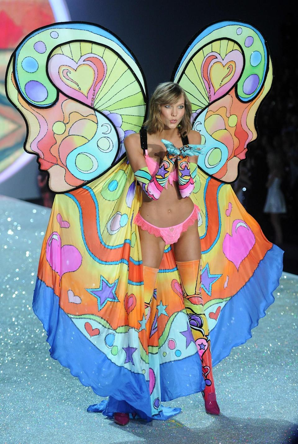 <p>Karlie Kloss's psychedelic number worn in 2013 is pretty hard to forget. [Photo: Getty] </p>
