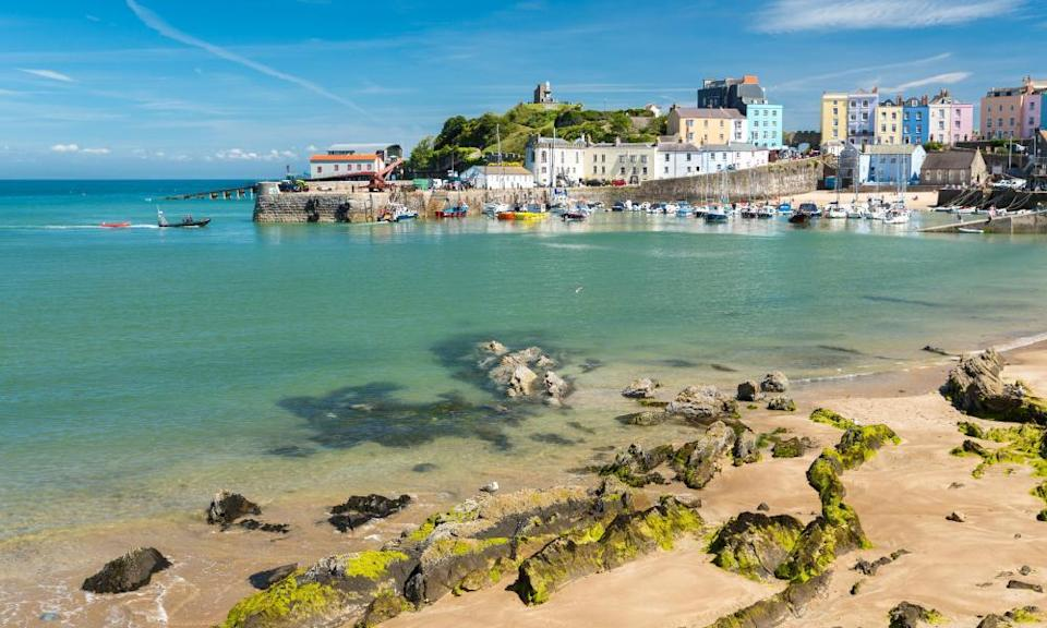 Tenby harbour with beach and castle