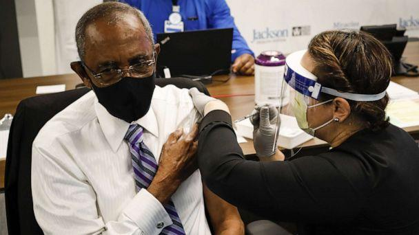 PHOTO: In this Dec. 30, 2020, file photo, a healthcare worker gives the Pfizer/BioNTech vaccine to Patrick Range, Sr, 88, as part of COVID-19 vaccination plan for the seniors at the Jackson Memorial Hospital in Miami. (Marco Bello/Anadolu Agency via Getty Images, FILE)
