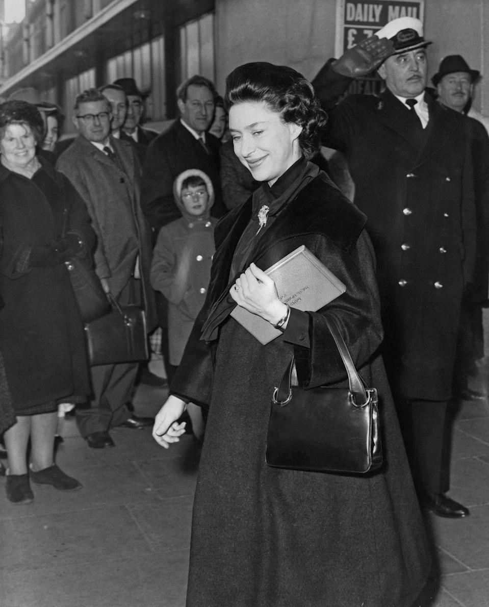 <p>Princess Margaret uses a loose overcoat to accommodate her growing bump.</p>