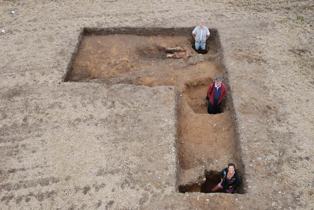 The archaeological team inside the postholes from the later Roman building. Decorated wall plaster was excavated from them. CREDIT: William Bowden