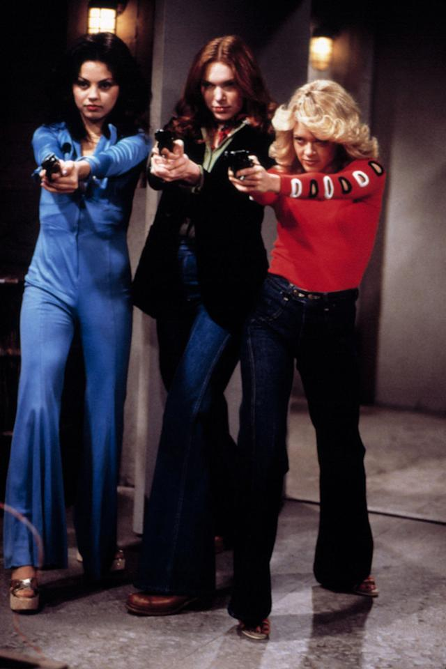 "Mila Kunis, Laura Prepon, and Lisa Robin Kelly in ""That '70s Show."""