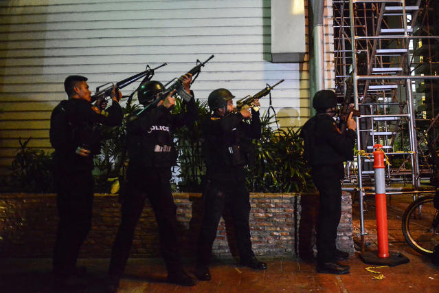 <p>Filipino elite Police Special Weapons and Tactical (SWAT) personnel take their position outside the Resort World Manila hotel in Pasay city, south of Manila, Philippines, June 2, 2017. (Photo: Ezra Acayan/EPA) </p>