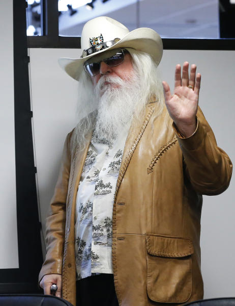 FILE - In this Jan. 29, 2013, file photo, Leon Russell waves as he is introduced in Tulsa, Okla. Russell, who sang, wrote and produced some of rock 'n' roll's top records, has died. (AP Photo/Sue Ogrocki, File)