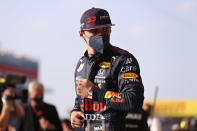 Red Bull driver Max Verstappen of the Netherlands stands in the pit lane at the end of the qualifying session ahead of Sunday's British Formula One Grand Prix, at the Silverstone circuit, in Silverstone, England, Friday, July 16, 2021. (Lars Baron/Pool photo via AP)