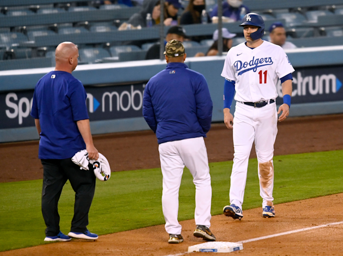 The Dodgers' AJ Pollock tests his hamstring in the second inning May 14, 2021.