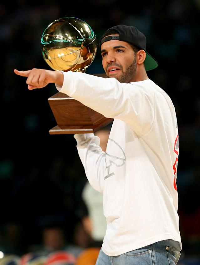NEW ORLEANS, LA - FEBRUARY 15: Drake carries the Sprite Slam Dunk Contest 2014 trophy before the contest as part of the 2014 NBA All-Star Weekend at the Smoothie King Center on February 15, 2014 in New Orleans, Louisiana. NOTE TO USER: User expressly acknowledges and agrees that, by downloading and or using this photograph, User is consenting to the terms and conditions of the Getty Images License Agreement. (Photo by Ronald Martinez/Getty Images)