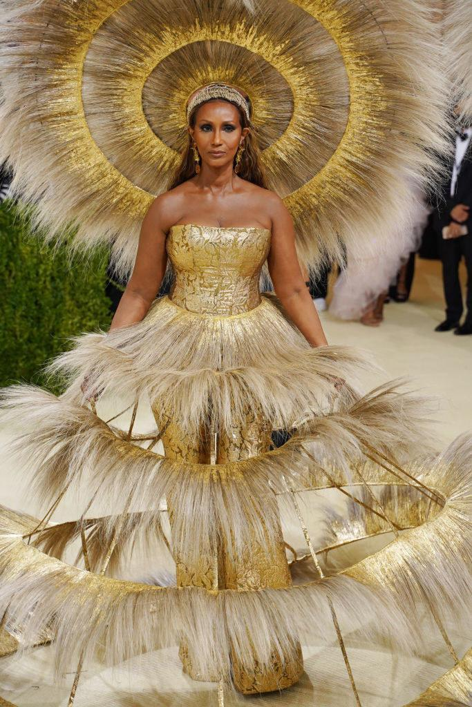 Iman wore an elaborate metallic strapless jumpsuit with a feathered skirt and matching headdress