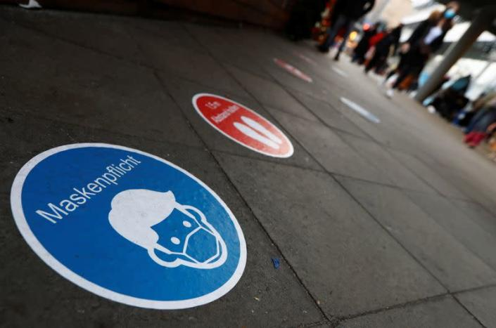 A social distancing floor sign is seen at Schloss Strasse shopping street amid the coronavirus disease (COVID-19) outbreak in Berlin
