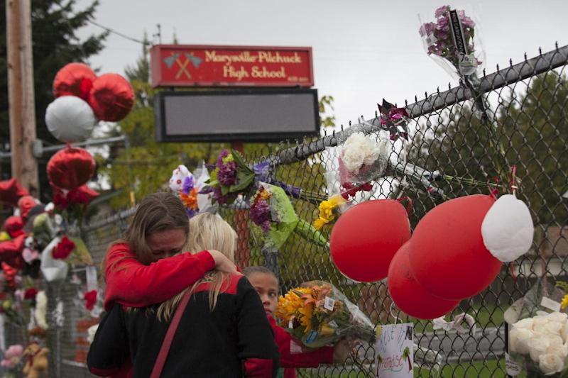 A makeshift memorial is set up outside Marysville-Pilchuck High School on October 26, 2014 in Marysville, Washington, following a shooting rampage by a student