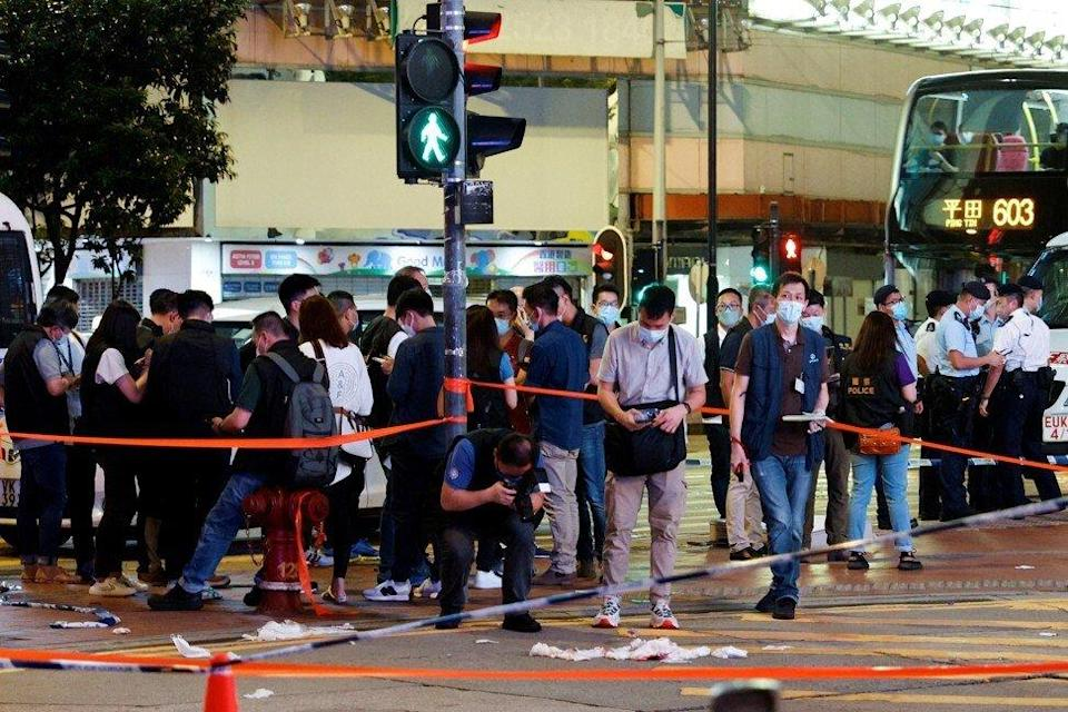 Police investigate the stabbing of an officer in Causeway Bay on July 1. Photo: Reuters