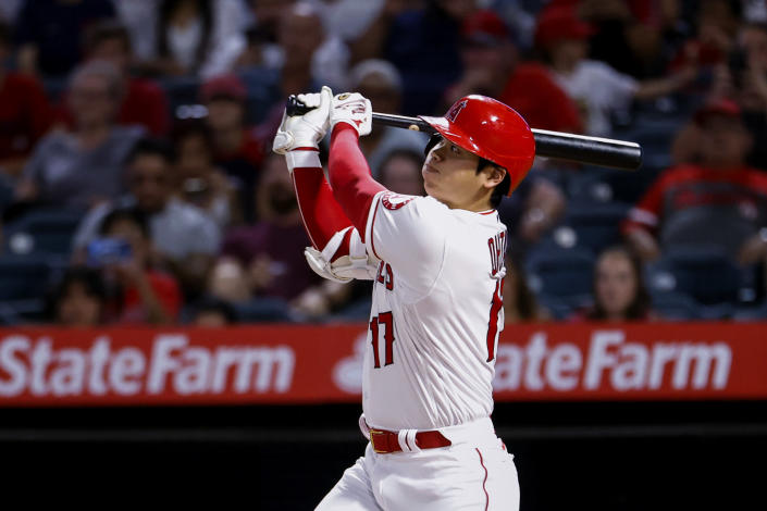 Los Angeles Angels' Shohei Ohtani watches his three-run home run during the sixth inning of the team's baseball game against the Texas Rangers in Anaheim, Calif., Saturday, Sept. 4, 2021. (AP Photo/Ringo H.W. Chiu)
