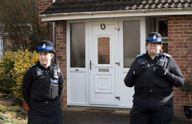 Police officers on guard at the Salisbury Skripal family home