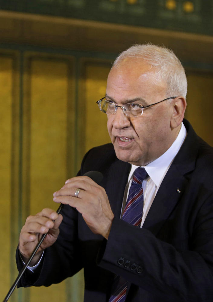 FILE - In this Aug. 11, 2014 file photo, Palestinian negotiator, Saeb Erekat, speaks during a press conference, following an emergency meeting at the Arab League headquarters in Cairo, Egypt. Erekat, a veteran peace negotiator and prominent international spokesman for the Palestinians for more than three decades, died Tuesday, Nov. 10, 2020. He was 65. (AP Photo/Amr Nabil, File)