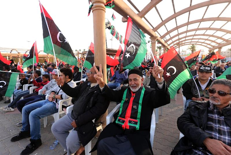 Libyans take part in celebrations marking the fifth anniversary of the Libyan revolution which toppled strongman Moamer Kadhafi, at Martyrs' Square in the capital Tripoli, on February 15, 2016 (AFP Photo/Mahmud Turkia)
