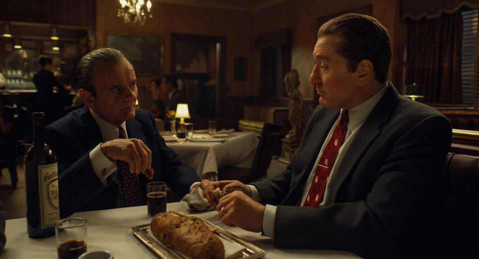"This image released by Netflix shows Joe Pesci, left, and Robert De Niro in a scene from ""The Irishman."" The film is nominated for a Golden Globe for best motion picture drama. (Netflix via AP)"