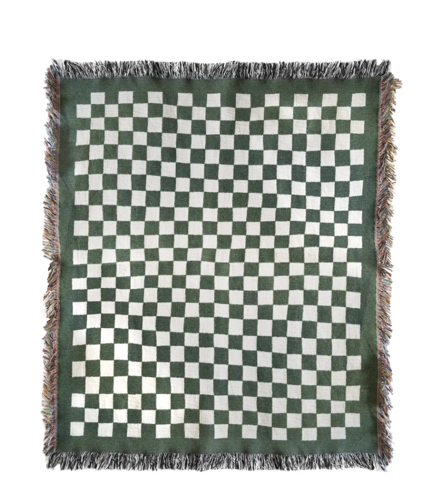 """<p><strong>Bien Mal</strong></p><p>bienmal.com</p><p><strong>$189.00</strong></p><p><a href=""""https://bienmal.com/collections/all/products/mate-throw-blanket"""" rel=""""nofollow noopener"""" target=""""_blank"""" data-ylk=""""slk:Shop Now"""" class=""""link rapid-noclick-resp"""">Shop Now</a></p><p>A cozy throw blanket, like this one from Cali-based brand Bien Mal, is never a bad idea.</p>"""