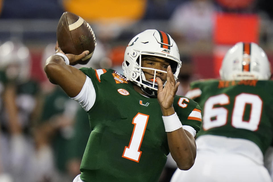 Miami quarterback D'Eriq King looks for a receiver against Oklahoma State during the first half of the Cheez-it Bowl NCAA college football game, Tuesday, Dec. 29, 2020, in Orlando, Fla. (AP Photo/John Raoux)