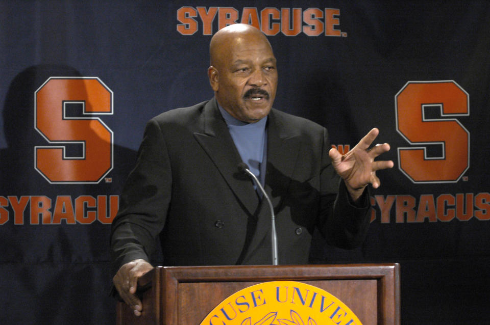 FILE - In this Nov. 11, 2005, file photo, Jim Brown answers questions during a news conference about the retirement of the No. 44 jersey at Syracuse University in Syracuse, N.Y. Syracuse was one of the standard-bearers in terms of accepting athletes based on performance and ability. Its history includes: Wilmeth Sidat-Singh, a quarterback and the first star Black athlete at the school in the 1930s; Bernie Custis, who quarterbacked the Orange from 1948-50 and became the first Black professional quarterback in the modern era with the Hamilton Tiger-Cats of the Canadian Football League; Jim Brown, regarded by many as the greatest running back of all time, starred at Syracuse in the mid-1950s and has dedicated much of his life to issues of social justice; and former Orange tailback Ernie Davis, the first Black to win the Heisman Trophy (1961). (AP Photo/Kevin Rivoli, File)