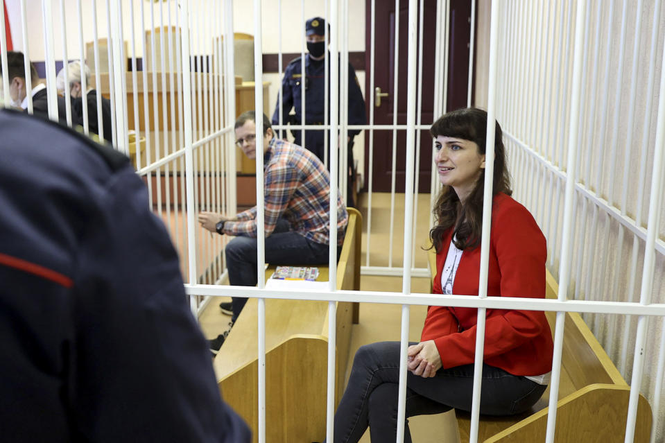 Belarusian journalist Katsiaryna Barysevich, right, and Dr. Artom Sorokin attend a court hearing in Minsk, Belarus, Friday, Feb. 19, 2021. Barysevich is accused of revealing personal data in her report on the death of a protester, part of the Belarusian authorities to stifle independent media reports about protests against authoritarian President Alexander Lukashenko. Amnesty International has declared Barysevich and Sorokin prisoners of conscience. (Ramil Nasibulin/BelTA pool photo via AP)