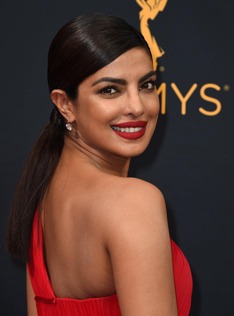 <p><b>Priyanka Chopra</b></p><p>The <i>Quantico</i> star has thick, luscious hair, but sometimes you just want to keep it under wraps for the evening. (Photo: AP Images)</p>