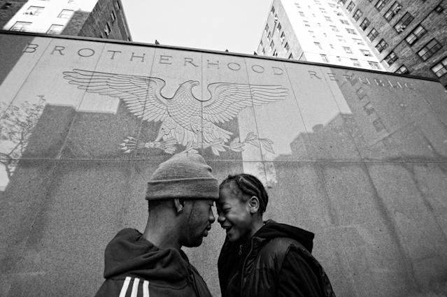 <p>Jerell Willis and son Fidel on a walk through their neighborhood, New York, N.Y., 2012. (Photograph © Zun Lee) </p>