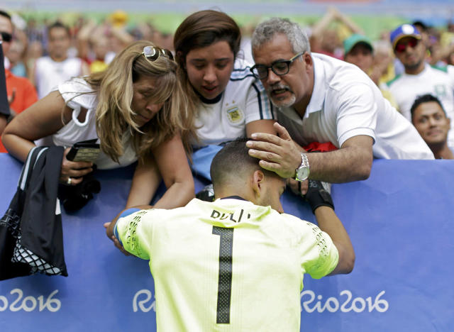 <p>Goalkeeper Geronimo Rulli of Argentina is consoled as he cries after their match as Argentina is eliminated from the Rio Olympics soccer tournament on August 10, 2016. (REUTERS/Ueslei Marcelino) </p>