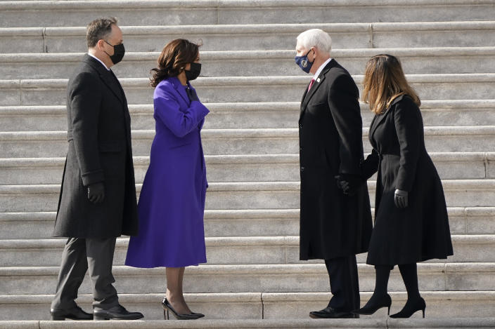 Vice President Kamala Harris and her husband Doug Emhoffl left, and former Vice President Mike Pence and his wife Karen Pence speak before the Pence's depart the Capitol after the Inauguration of President Joe Biden ceremony on the East Front of the Capitol at the conclusion of the inauguration ceremonies, in Washington, Wednesday, Jan. 20, 2021. (AP Photo/J. Scott Applewhite)