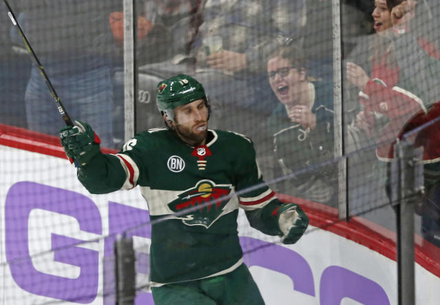 Fans celebrate along with Minnesota Wild's Jason Zucker after he scored a goal against the Arizona Coyotes during the second period of an NHL hockey game Tuesday, Nov. 27, 2018, in St. Paul, Minn. (AP Photo/Jim Mone)