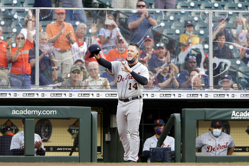 Detroit Tigers manager A.J. Hinch (14), the former Houston Astros manager, comes out of the dugout to acknowledge the crowd on his first visit back to Minute Maid Park before a baseball game against the Astros, Monday, April 12, 2021, in Houston. Hinch was fired by the Astros in 2019 for his part in the Astros cheating scandal. (AP Photo/Michael Wyke)