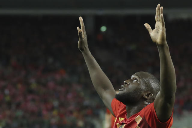Belgium's Romelo Lukaku, center, jubilates after scoring during the Euro 2020 group I qualifying soccer match between Belgium and San Marino at the King Baudouin Stadium in Brussels, Thursday, Oct. 10, 2019. (AP Photo/Francisco Seco)