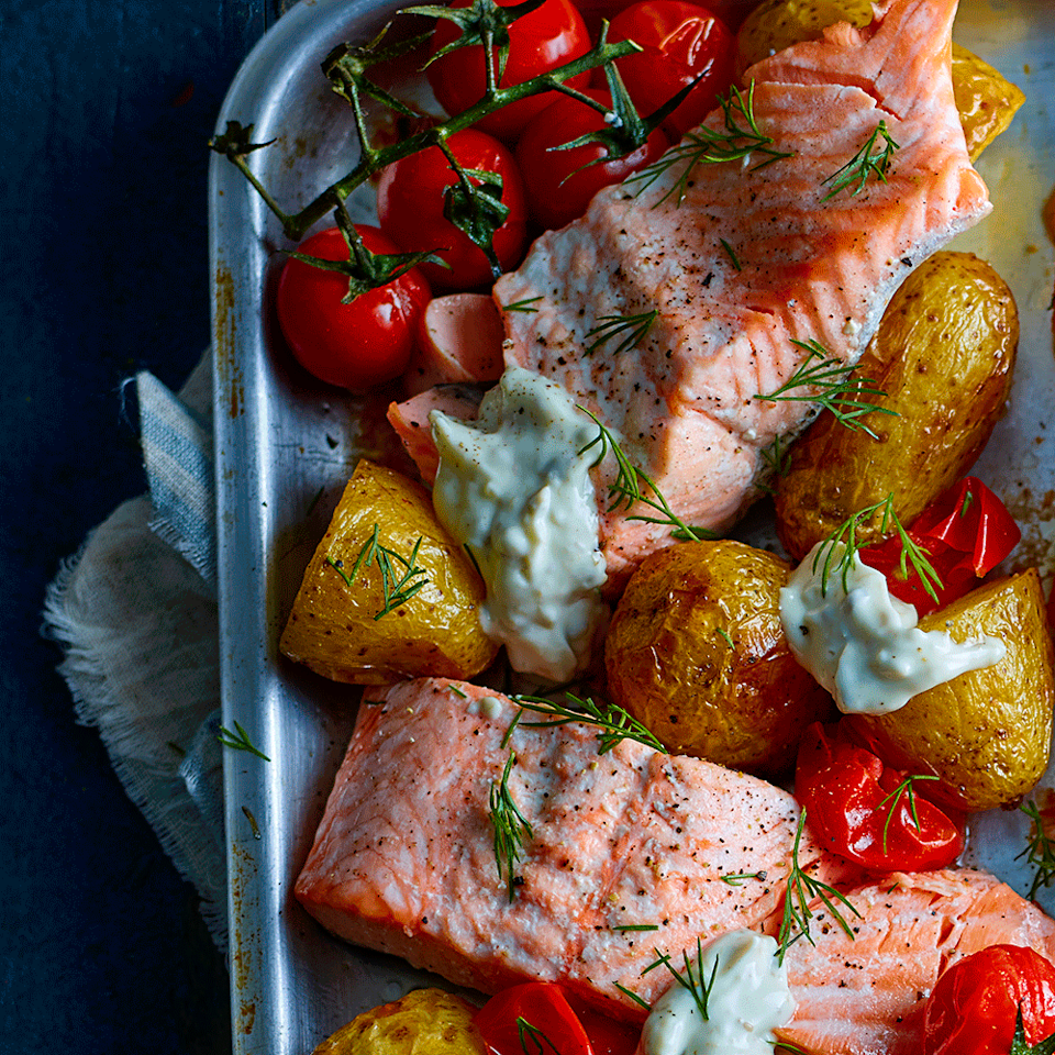 """<p>This tasty salmon tray bake couldn't be easier and is low in calories.</p><p><strong>Recipe: <a href=""""https://www.goodhousekeeping.com/uk/food/recipes/a567621/salmon-potato-traybake/"""" rel=""""nofollow noopener"""" target=""""_blank"""" data-ylk=""""slk:Salmon, potato and tartare sauce tray bake"""" class=""""link rapid-noclick-resp"""">Salmon, potato and tartare sauce tray bake</a></strong></p>"""
