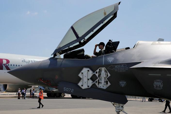 A U.S. airman adjusts his cap in the cockpit as a Lockheed Martin F-35 Lightning II aircraft is moved on the eve of the 52nd Paris Air Show at Le Bourget Airport near Paris, France June 18, 2017. REUTERS/Pascal Rossignol