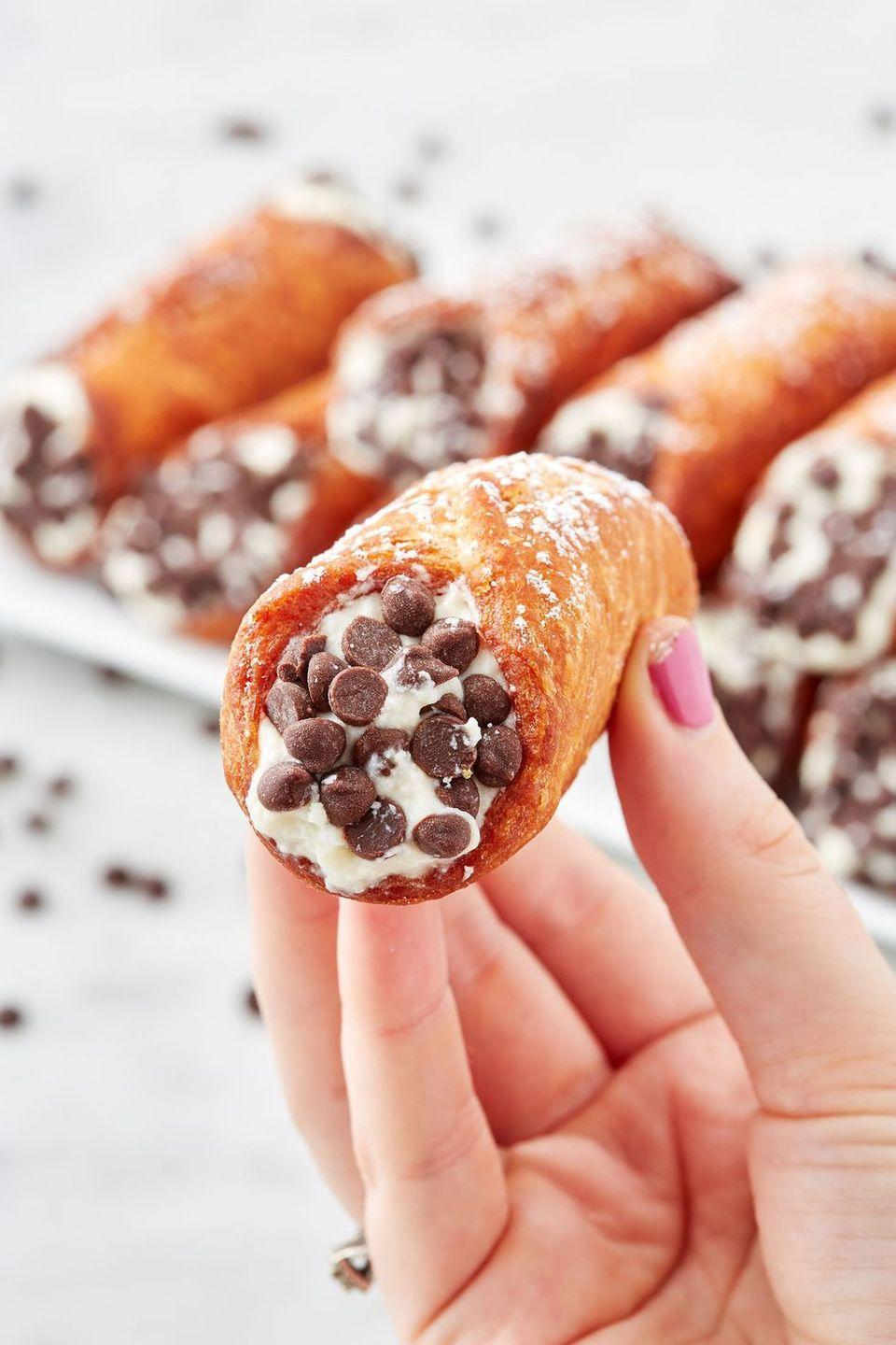 """<p>*Crams in as many chocolate chips as possible.* </p><p>Get the recipe from <a href=""""https://www.delish.com/cooking/recipe-ideas/a28626292/homemade-classic-cannoli-recipe/"""" rel=""""nofollow noopener"""" target=""""_blank"""" data-ylk=""""slk:Delish"""" class=""""link rapid-noclick-resp"""">Delish</a>.</p>"""